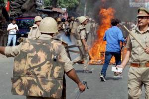 Saharanpur: Police in action after a violence broke out during an Ambedkar Jayanti Shobhayatra in Saharanpur on Thursday. PTI Photo  (PTI4_20_2017_000180B)