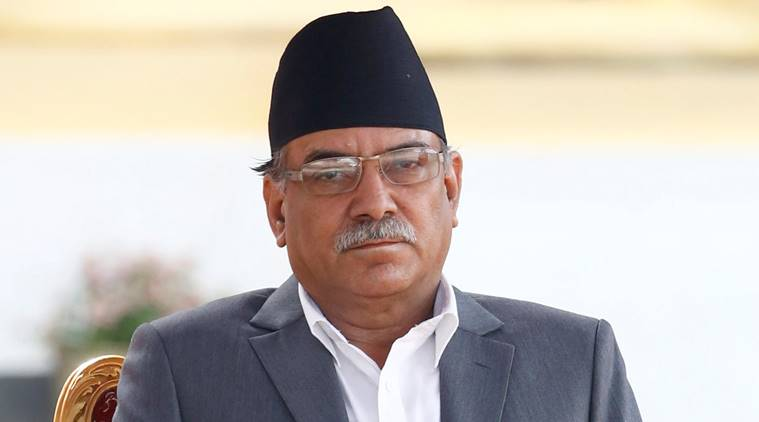 """Newly elected Nepalese Prime Minister Pushpa Kamal Dahal, also known as Prachanda, (L) sits on a chair upon his arrival to administers the oath of office at the presidential building """"Shital Niwas"""" in Kathmandu, Nepal, August 4, 2016. REUTERS/Navesh Chitrakar"""