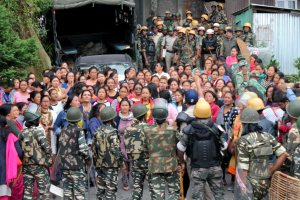 Darjeeling: Security forces personnel trying to control woman Gorkha Janamukti Morcha (GJM) supporters during a protest at their office Patlebash in Darjeeling on Thursday. PTI Photo  (PTI6_15_2017_000215B)
