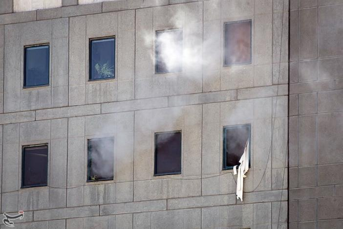 Smoke is seen during an attack on the Iranian parliament in central Tehran, Iran, June 7, 2017. Tasnim News Agency/Handout via REUTERS