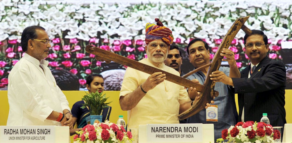 "The Prime Minister, Shri Narendra Modi being presented a ""Plough"" as symbol of farming at the launching ceremony of DD Kisan Channel, in New Delhi on May 26, 2015. The Union Minister for Agriculture, Shri Radha Mohan Singh is also seen."