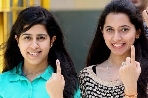 New Delhi: Young Girls show their mark after casting their vote for Lok Sabha election in New Delhi on Thursday. PTI Photo by Manvender Vashist(PTI4_10_2014_000169B)