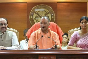 Lucknow:  Uttar Pradesh Chief Minister Yogi Aditiyanath addressing a press conference in Lucknow on Saturday. Union Minister Anupriya Patel and Uttar Pradesh Health Minister Siddharth Nath Singh are also seen.  PTI Photo by Nand Kumar (PTI8_12_2017_000138B)