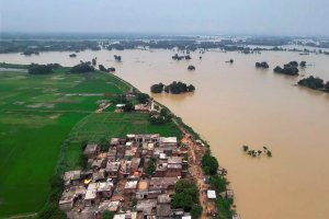Gorakhpur: A view of a flooded region in eastern Uttar Pradesh on Wednesday. PTI Photo  (PTI8_24_2017_000228B)