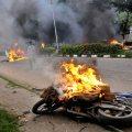 Panchkula: Vehicles burn in violence following Dera Sacha Sauda chief Gurmeet Ram Rahim's conviction in Panchkula on Friday. PTI Photo (PTI8_25_2017_000164B)