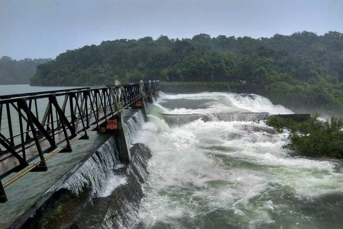 Kolhapur: Water gushes out of the gates of Radhanagari dam as water level rises due to heavy rains in Kolhapur, Maharashtra on Saturday. PTI Photo(PTI8_26_2017_000177B)