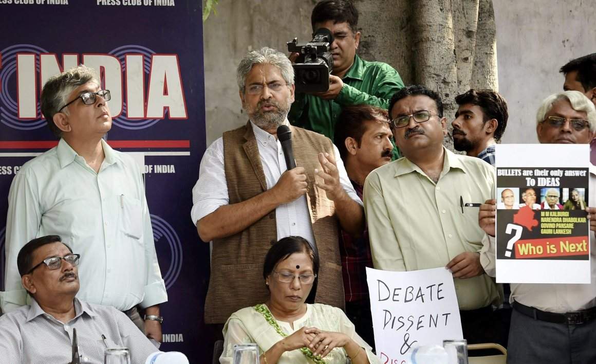 New Delhi: Journalist fraternity gather to demonstrate a protest against the killing of journalist Gauri Lankesh, at the Press Club of India in New Delhi on Wednesday. PTI Photo by Kamal Singh(PTI9_6_2017_000152A)