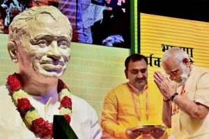 New Delhi: Prime Minister Narendra Modi pays floral tributes to the bust of Shyama Prasad Mukherjee at BJPs national executive meeting at Talkatora stadium, in New Delhi on Monday. PTI Photo by Kamal Kishore (PTI9 25 2017 000034B)