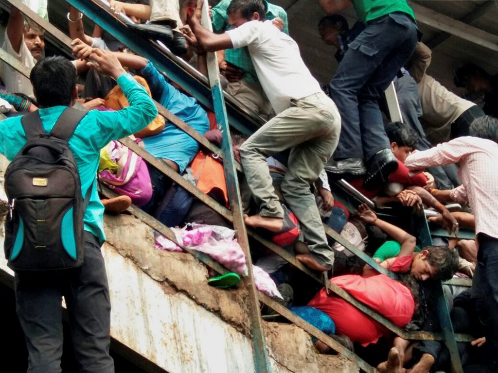 Mumbai: Passengers caught in a stampede at Elphinstone railway stations foot over bridge in Mumbai on Friday. PTI Photo (PTI9 29 2017 000043A)