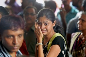 Mumbai: Relatives of the stampede victims near the mortuary of a hospital in Mumbai on Friday. At least 22 people were killed and 39 others were injured in the stampede at Elphinstone railway station on Friday. PTI Photo by Shashank Parade  (PTI9_29_2017_000067B)