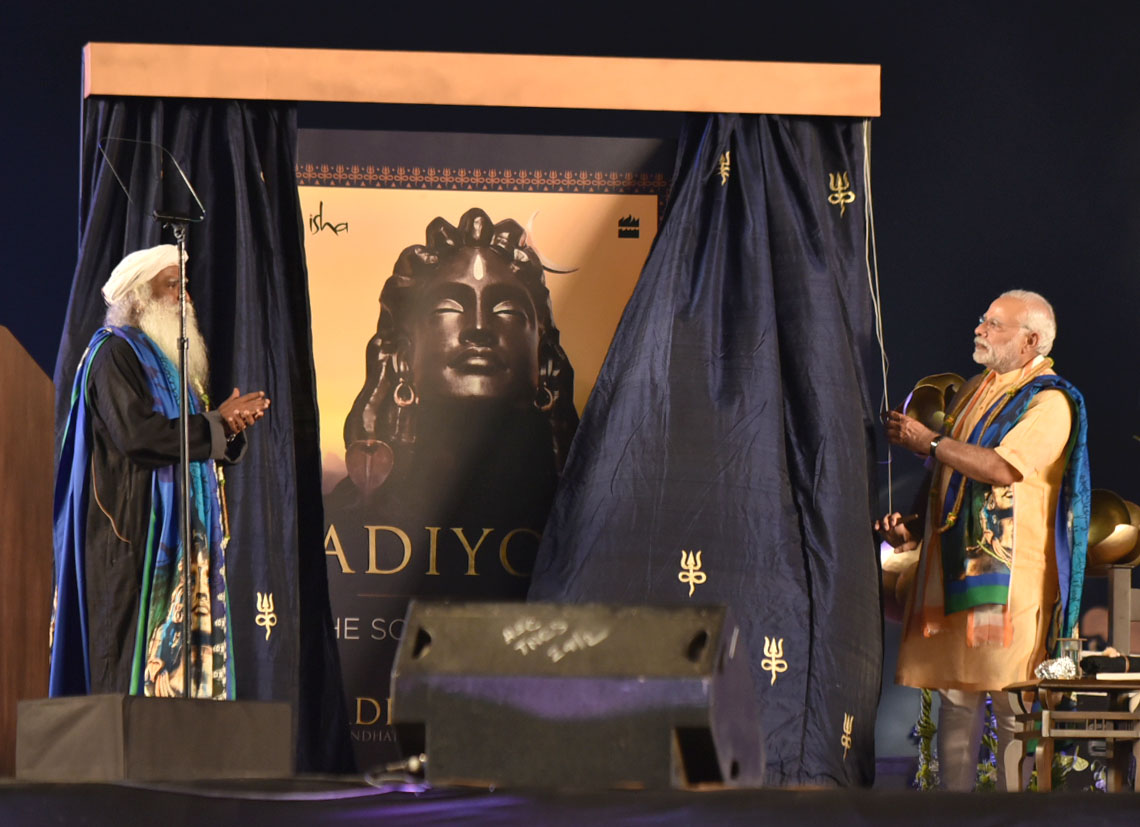 The Prime Minister, Shri Narendra Modi releasing the book 'Adiyogi - The Source of Yoga', at the programme, organised by the Isha Foundation Sadhguru JV, in Coimbatore, Tamil Nadu on February 24, 2017.