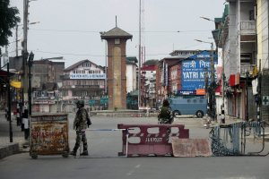 Srinagar:  Security personnel guarding at Lal Chowk during curfew in Srinagar on Tuesday. PTI Photo by S Irfan      (PTI9_13_2016_000101B)