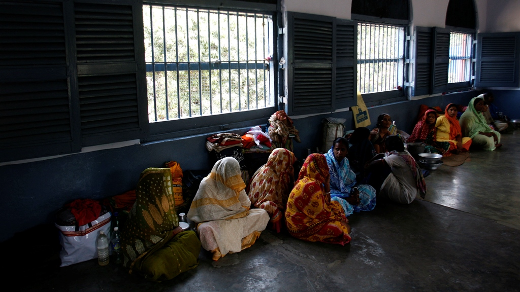 Female prisoners sit inside their cell in the eastern Indian city of Kolkata . (Photo: Reuters)