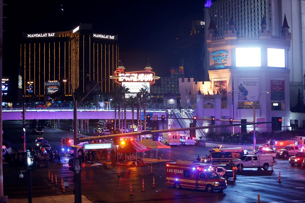 Las Vegas Metro Police and medical workers stage in the intersection of Tropicana Avenue and Las Vegas Boulevard South after a mass shooting at a music festival on the Las Vegas Strip in Las Vegas, Nevada, U.S. October 1, 2017. REUTERS/Las Vegas Sun/Steve Marcus - RC1BEC59EC90