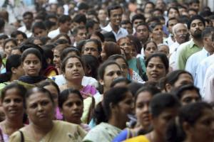 Passengers wait in queues to enter a railway station in Mumbai November 13, 2006. Hundreds of thousands of train commuters in India's financial hub were frisked on Monday in a massive drill to check the preparedness of a city that has faced repeated bomb attacks.  REUTERS/Punit Paranjpe  (INDIA)