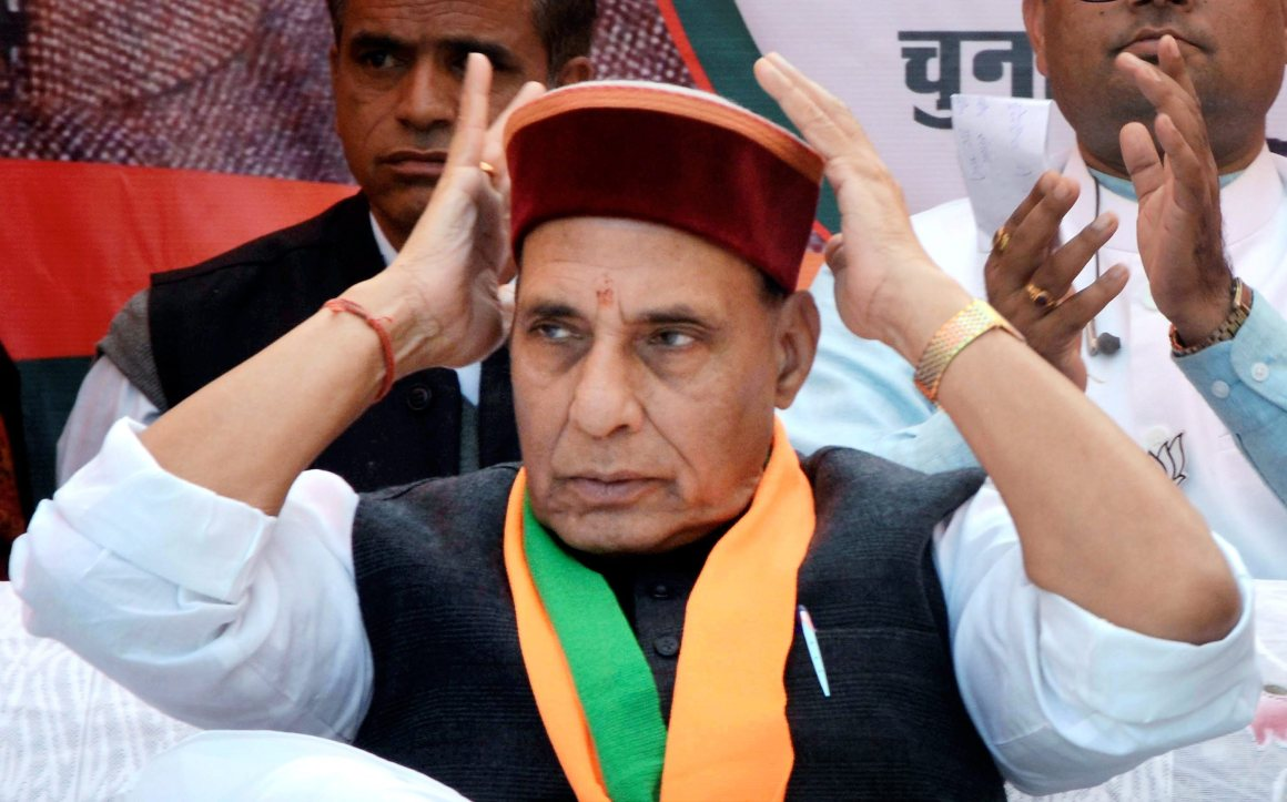 Mandi: Union Home Minister Rajnath Singh wears a Himachali cap during an election campaign rally at Majhwar in Mandi on Thursday. PTI Photo (PTI11_2_2017_000166B)