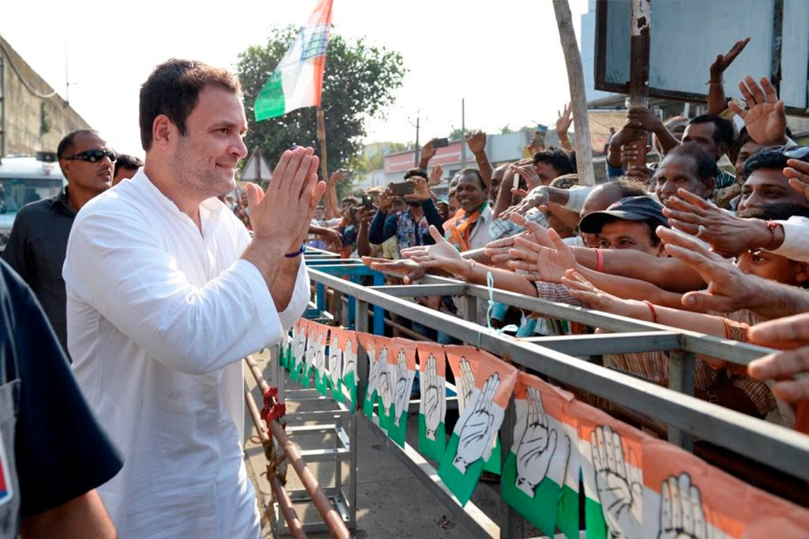 Valsad: Congress vice-president Rahul Gandhi greeting people during his road show at Valsad district, in Gujarat on Friday. PTI Photo(PTI11_3_2017_000151A)