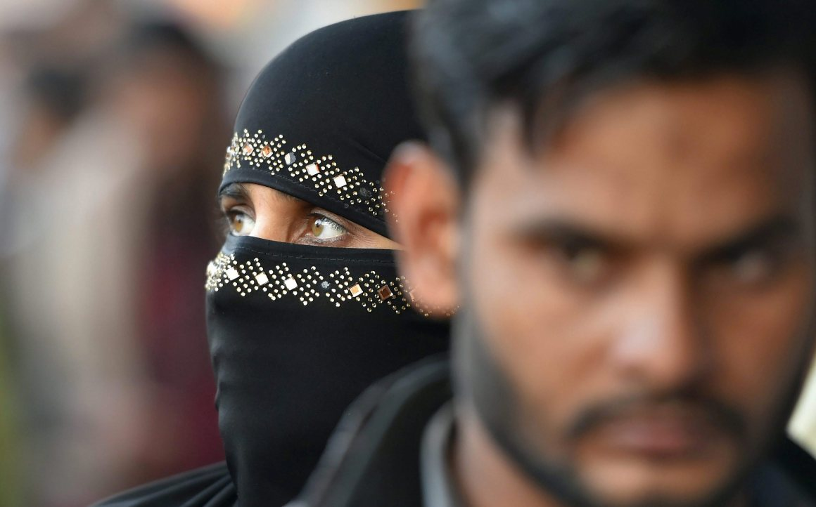 New Delhi: A Muslim woman at a market in the walled city area of Delhi on Thursday. The Muslim Women (Protection of Rights of Marriage) Bill, 2017, which makes instant triple talaq illegal and void, was introduced in Parliament. PTI Photo by Shahbaz Khan (PTI12_28_2017_000142B)