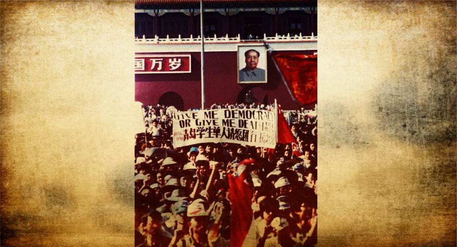 "Chinese students carry a sign that reads, ""Give me democracy or give me death,"" during a demonstration in Tiananmen Square May 14, 1989. DOMINIC DUDOUBLE/REUTERS"