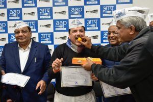 New Delhi: AAP leader ND Gupta offers sweets to newly-elected Rajya Sabha MPs Sushil Gupta, Sanjay Singh and ND Gupta in New Delhi on Monday. PTI Photo by Ravi Choudhary (PTI1 8 2018 000140B)