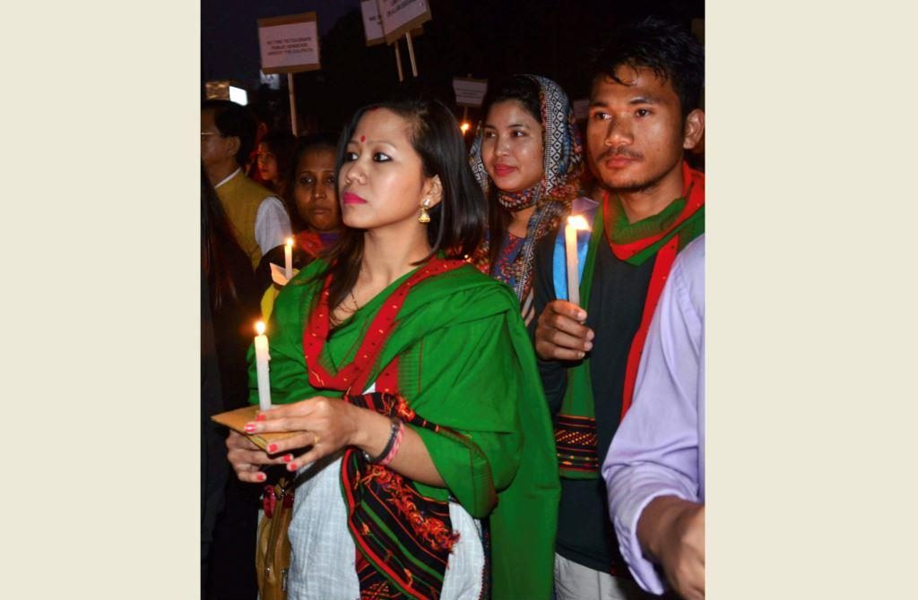 Guwahati: People take part in a candlelight march against the death of two protesters killed in police firing while they were protesting against the inclusion of Dima Hasong land in Naga Accord, in Guwahati on Saturday. PTI Photo (PTI1_27_2018_000177B)