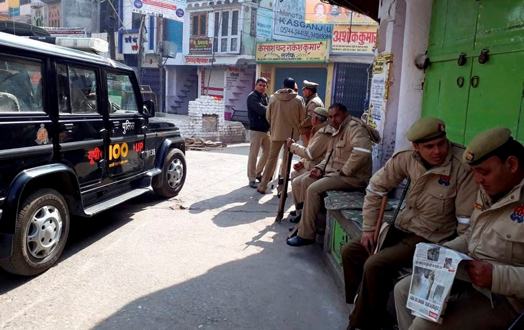 Kasganj (UP): More than 80 persons were arrested while Rapid Action Force (RAF) and Provincial Armed Constabulary (PAC) personnel intensified vigil in Kasganj on Sunday. PTI Photo (PTI1_28_2018_000205B)