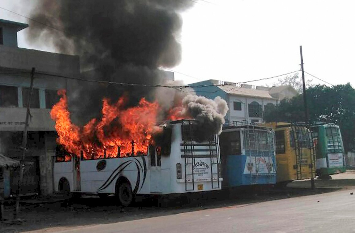 Kasganj: A bus set on fire by a group of people who went on a rampage after the cremation of a young man killed on Friday during the Tiranga bike rally, in Kasganj on Saturday. PTI Photo (PTI1_27_2018_000204B) *** Local Caption ***