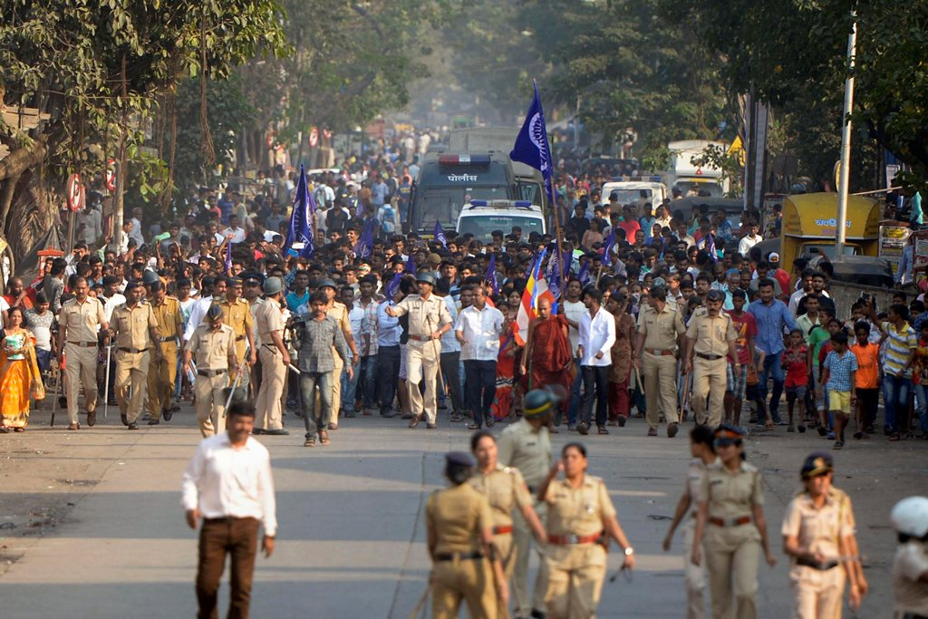 Mumbai: Policemen accompany the Dalits protestors as they stage a protest against the violence in Bhima Koregaon area of Pune, in Mumbai on Tuesday. PTI Photo by Shashank Parade (PTI1_2_2018_000159B)