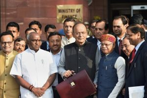 New Delhi: Union Finance Minister Arun Jaitley along with MoS Finance ministers Shiv Pratap Shukla, P Radhakrishnan and Economic Affairs Secretary Shaktikanta Das leaves the North Block to present the Union Budget at Parliament, in New Delhi on Thursday.  Finance Secretary Hasmukh Adhia and Chief Economic Advisor Arvind Subramanian are also seen. PTI Photo by Manvender Vashist (PTI2_1_2018_000009B)