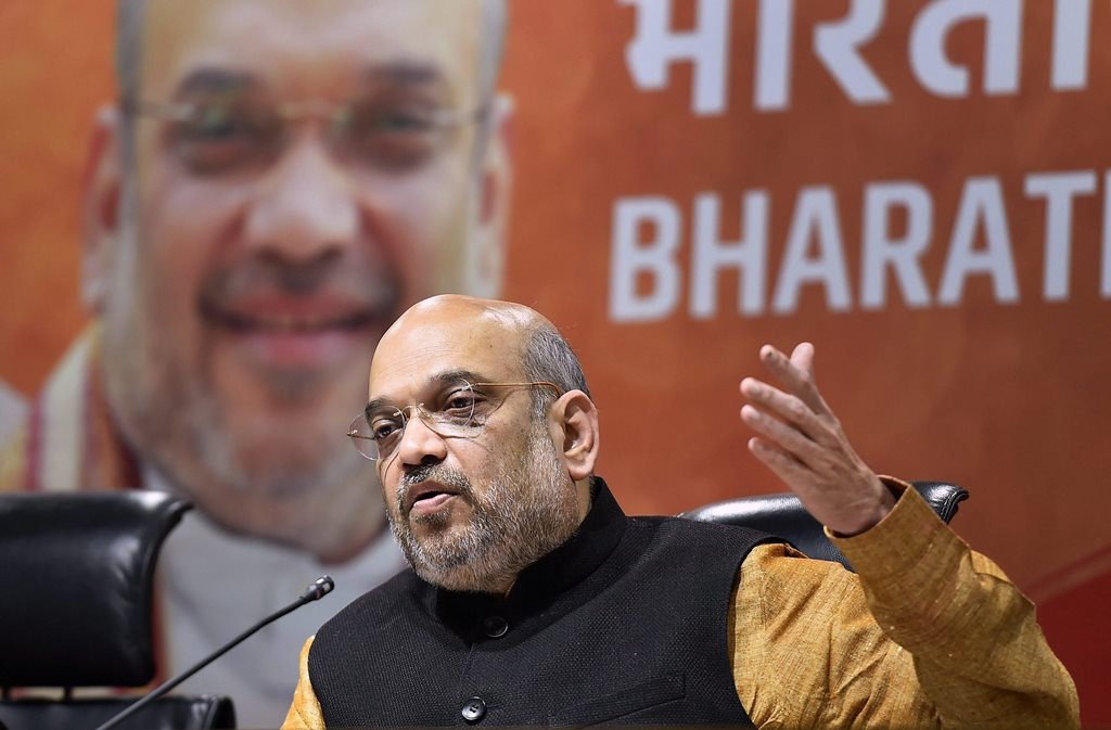 New Delhi: BJP President Amit Shah speaks during a press conference after their victory in North-East Assembly election at party headquarters in New Delhi on Saturday. PTI Photo by Kamal Singh (PTI3_3_2018_000146B)