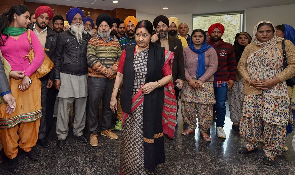**FILE PHOTO** New Delhi: In this file photo dated 7 Feb, 2016, External Affairs Minister Sushma Swaraj meets with the family members of Indians stuck in Iraq, at Jawahar Lal Bhavan in New Delhi. External Affairs Minister Sushma Swaraj in a statement made at Rajya Sabha today, stated that the 39 bodies exhumed from a mount in Badoosh in Iraq have been identified as those of abducted Indians and will be brought back to India on a special plane. PTI Photo by Vijay Verma (PTI3_20_2018_000063B)