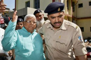 Ranchi: Former Bihar Chief Minister Lalu Prasad Yadav leaves special CBI court after being pronounced guilty in the fourth Dumka multi-crore fodder scam case, in Ranchi on Monday. PTI Photo (PTI3_19_2018_000049B)