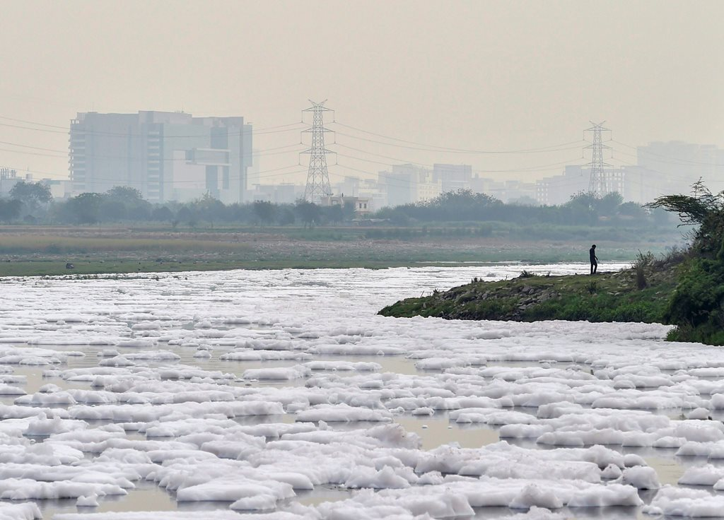 New Delhi: A view of foam-covered water, as a result of pollution, as seen from the banks of river Yamuna, near Kalindi Kunj in New Delhi, on Monday. According to the UN, the theme for World Water Day 2018, observed on March 22, is 'Nature for Water' – exploring nature-based solutions to the water challenges we face in the 21st century. PTI Photo by Ravi Choudhary(PTI3_21_2018_000117B)