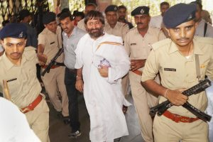 Surat: Police escort Asaram's son Narayan Sai for treatment to a hospital in Surat on Saturday. PTI Photo (PTI4_28_2018_000076B)