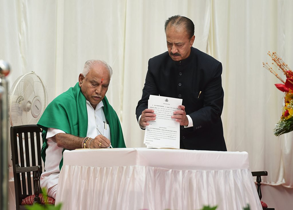 Bengaluru: BJP's B. S. Yeddyurappa signs a register after being sworn-in as Karnataka Chief Minister at a ceremony in Bengaluru on Thursday. (PTI Photo/Shailendra Bhojak)(PTI5_17_2018_000067B)