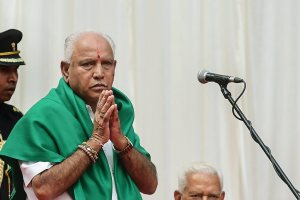 Bengaluru: BJP's B. S. Yeddyurappa gestures after he was sworn-in as Karnataka Chief Minister by Governor Vajubhai Vala (R) at a ceremony in Bengaluru on Thursday. (PTI Photo/Shailendra Bhojak)(PTI5_17_2018_000068B)