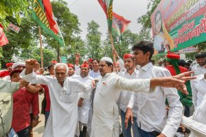 Lucknow: Samajwadi Party (SP) workers celebrate their party success in Uttar Pradesh by-elections, outside their party office in Lucknow on Thursday, May 31, 2018. (PTI Photo/Nand kumar)(PTI5_31_2018_000089B)