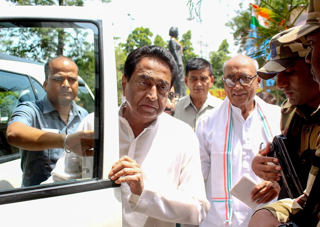 Bhopal: Congress Madhya Pradesh President Kamal Nath and AICC General Secretary Digvijay Singh arrive to chair Madhya Pradesh Congress Coordination Committee meeting at PCC Headquarters, in Bhopal, on Thursday. (PTI Photo) (PTI5_24_2018_000029B)