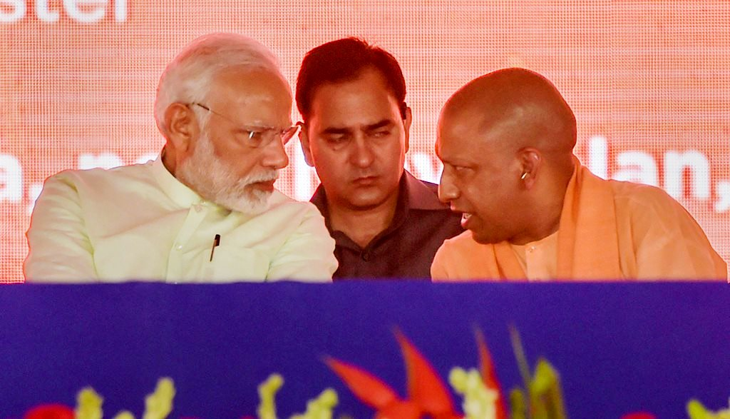 Baghpat: Prime Minister Narendra Modi with Uttar Pradesh Chief Minister Yogi Adityanath during the inauguration of 135km long Eastern Peripheral Expressway (NH-II) connecting Kundli to Palwal, at Bagpat, in Uttar Pradesh, on Sunday. (PTI Photo/Vijay Verma)(PTI5_27_2018_000090B)