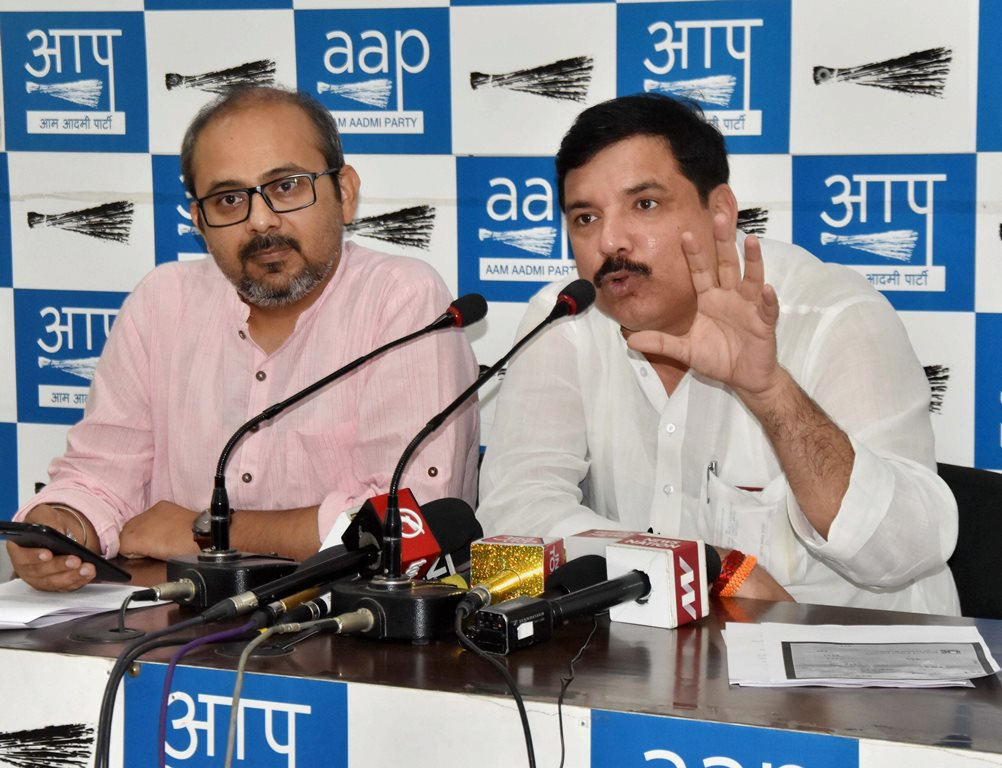 New Delhi: AAP leaders Sanjay Singh and Dilip Pande address a press conference on four years of BJP's government at the Centre, in New Delhi on Saturday. PTI Photo (PTI5_26_2018_000065B)