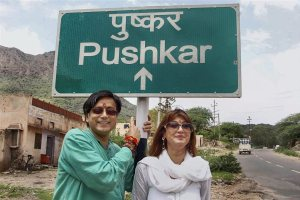 **FILE PHOTO** New Delhi: File photo dated August 08, 2010 shows Congress MP Shashi Tharoor with Sunanda Pushkar posing for a photograph against a signboard during their Ajmer visit. The Delhi Police on Monday filed a charge sheet in the death of Sunanda Pushkar, in which Tharoor has been named as an accused in the case. PTI Photo (PTI5_14_2018_000090B)