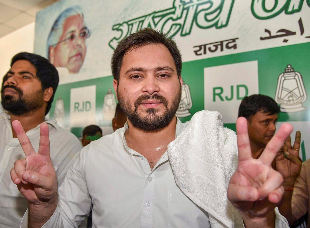 Patna: Rashtriya Janata Dal (RJD) leader Tejaswi Yadav flashes the victory sign after their party's victory at Jokihat Assembly by-elections, in Patna on Thursday, May 31, 2018. (PTI Photo) (PTI5_31_2018_000063B)