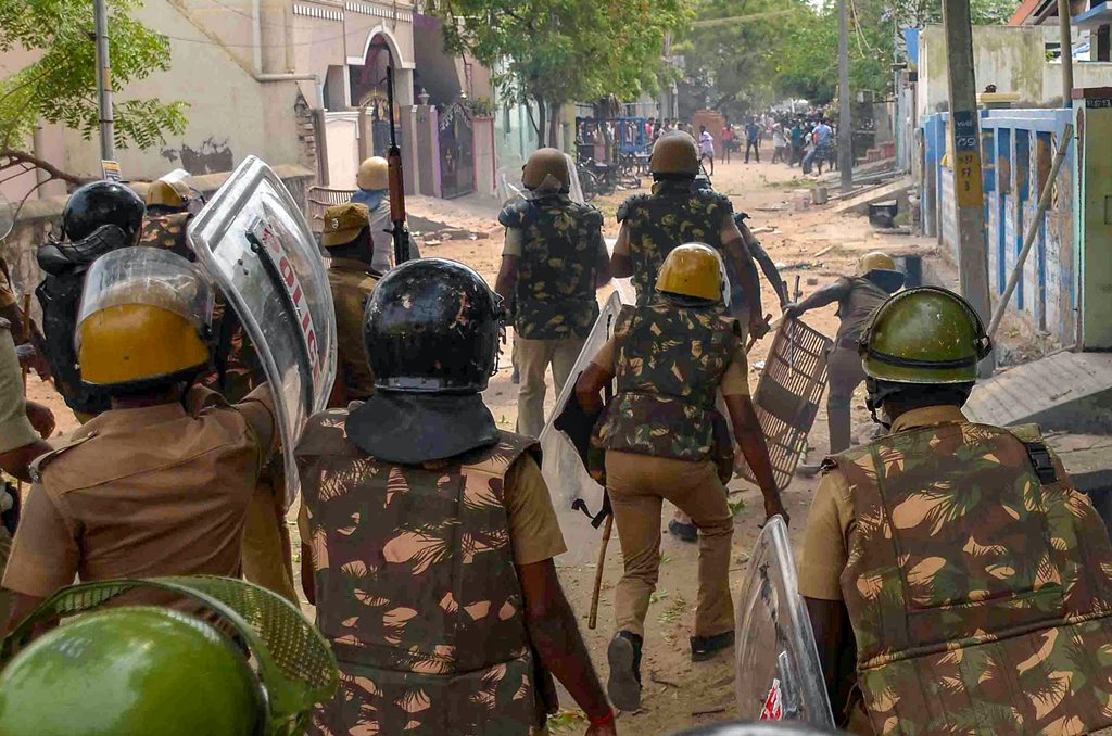 Tuticorin: Police personnel tackles as protestors demanding the closure of Vedanta's Sterlite Copper unit, gather in a street in Tuticorin, on Wednesday. In fresh violence today, one person was killed during the clash, after police's open fire killing at least ten people yesterday, and injuring many others. (PTI Photo)(PTI5_23_2018_000192B)