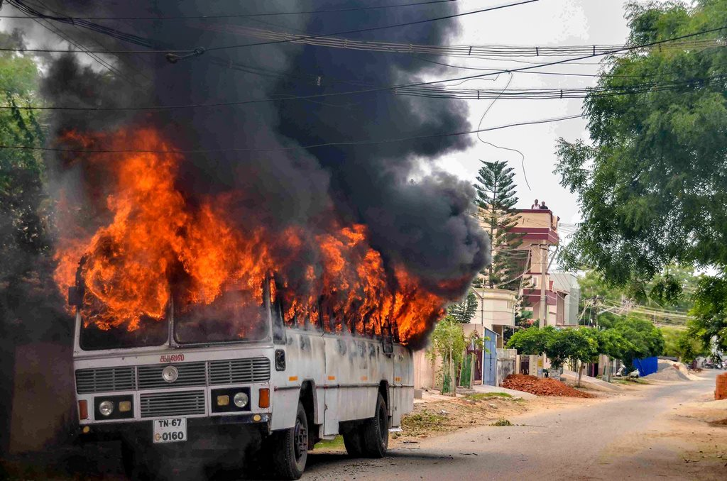 Tuticorin: Smoke billows from a buring bus during protests demanding the closure of Vedanta's Sterlite Copper unit, in Tuticorin, on Wednesday. In fresh violence today, one person was killed during the clash, after police's open fire killing at least ten people yesterday, and injuring many others. (PTI Photo) (PTI5_23_2018_000196B)
