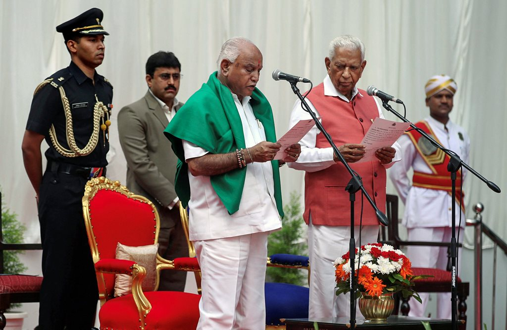Bengaluru: Karnataka Governor Vajubhai Vala administers oath to Bharatiya Janata Party (BJP) leader B. S. Yeddyurappa as Chief Minister of the state at a ceremony in Bengaluru on Thursday