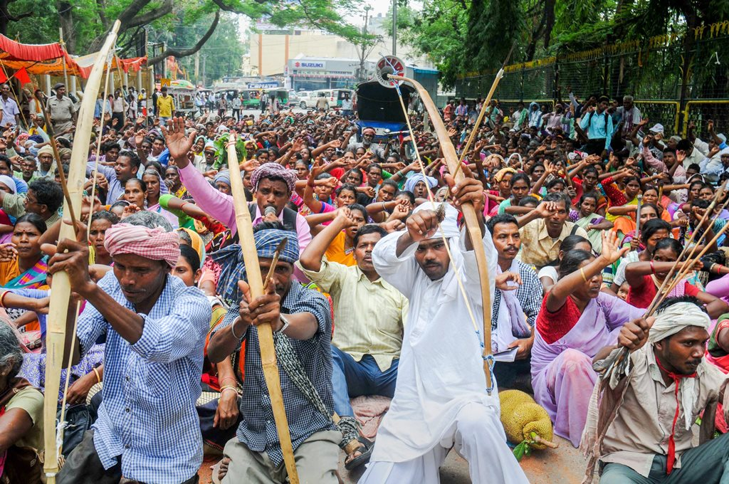 Ranchi: Tribals from various organizations hold bow and arrow during a protest against the state government Chotanagpur Tenancy (CNT) and Santal Pargana Tenancy (SPT) act, in front of the Governor's house, in Ranchi on Friday, June 08, 2018. (PTI Photo)(PTI6_8_2018_000052B)