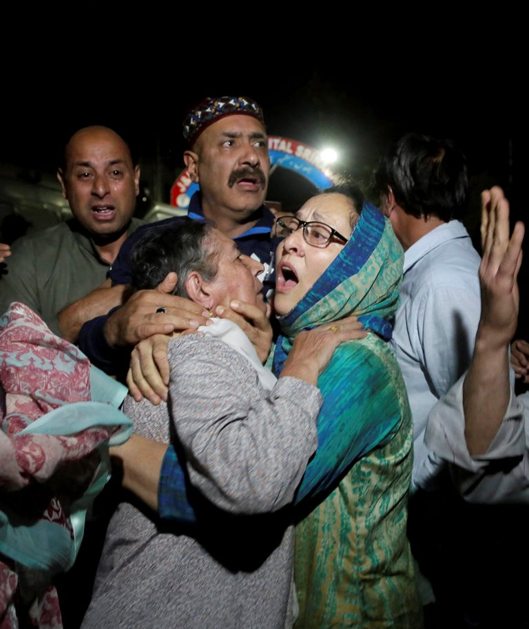"""Relatives and friends of the Editor of """"Rising Kashmir"""" Shujaat Bukhari, who was shot dead Thursday evening, cries inside a police control room in Srinagar, India, Thursday, June 14, 2018. Bukhari was attacked when he had just stepped out of his office in Press Colony in the city. He was reportedly hit by multiple bullets fired at a close range. A security guard protecting him and his driver were also shot.(PTI Photo) (PTI6_14_2018_000228B)"""