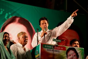 Lahore : Pakistani politician Imran Khan, chief of Pakistan Tehreek-e-Insaf party, addresses his supporters during an election campaign in Lahore, Pakistan, Monday, July 23, 2018. Pakistan will hold general elections on July 25. AP/PTI(AP7_24_2018_000002B)