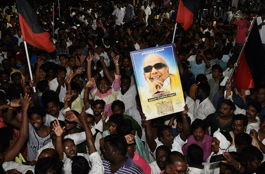 Chennai: Dravida Munnetra Kazhagam (DMK) supporters gather outside the hospital where DMK chief M Karunanidhi is being treated, in Chennai, on Sunday, July 29, 2018. (PTI Photo/R Senthil Kumar) (PTI7_30_2018_000068B)