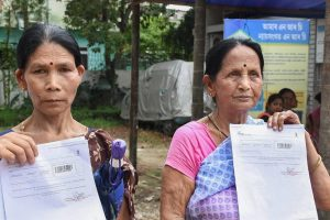 Guwahati: Maya Devi Sonar (left) and Malati Thapa, residents of Hatigaon, show documents outside the National Register of Citizens (NRC) Seva Kendra claiming that their and their family members' names were not included in the final draft of the state's NRC, in Guwahati on Monday, July 30, 2018. (PTI Photo) (PTI7_30_2018_000117B)